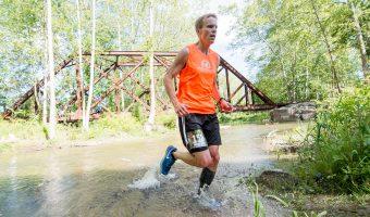 "Trophy Series Photo Contest Winner 7.13.17 - Randy Shemanski - ""Crossing Lick Brook during the Cayuga Trails Marathon."" Photo by Steven Gorgos."