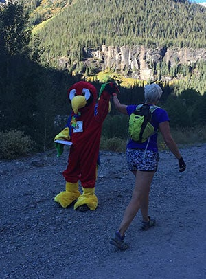 An aptly costumed volunteer at Camp Bird, on the climb to Imogene Pass.