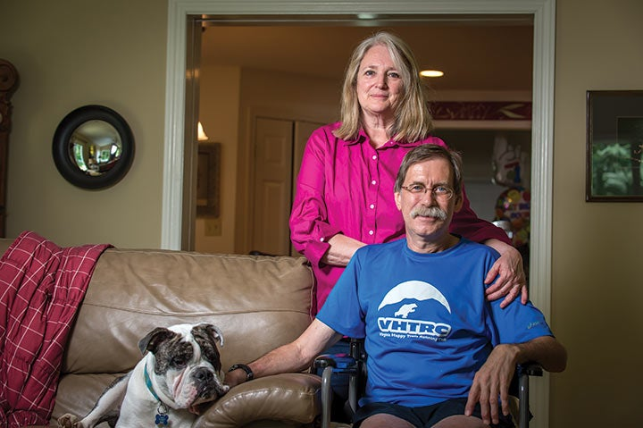 Runner Tom Green at home with his wife after an accident.