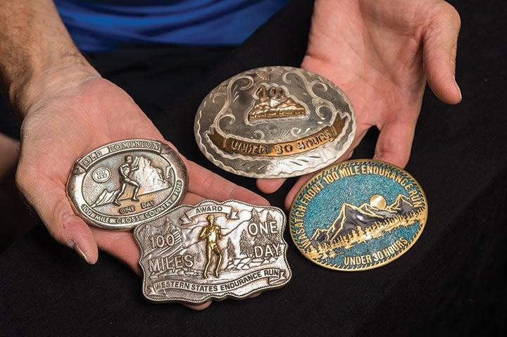 Runner Tom Green displays belt buckles from his 1986 Grand Slam of Ultrarunning