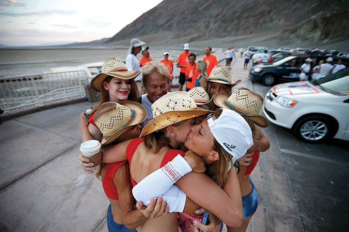Shannon (white cap) hugs her team before attempting her sixth finish of the Badwater 135, in 2013. Photo by Lucy Nicholson/Reuters